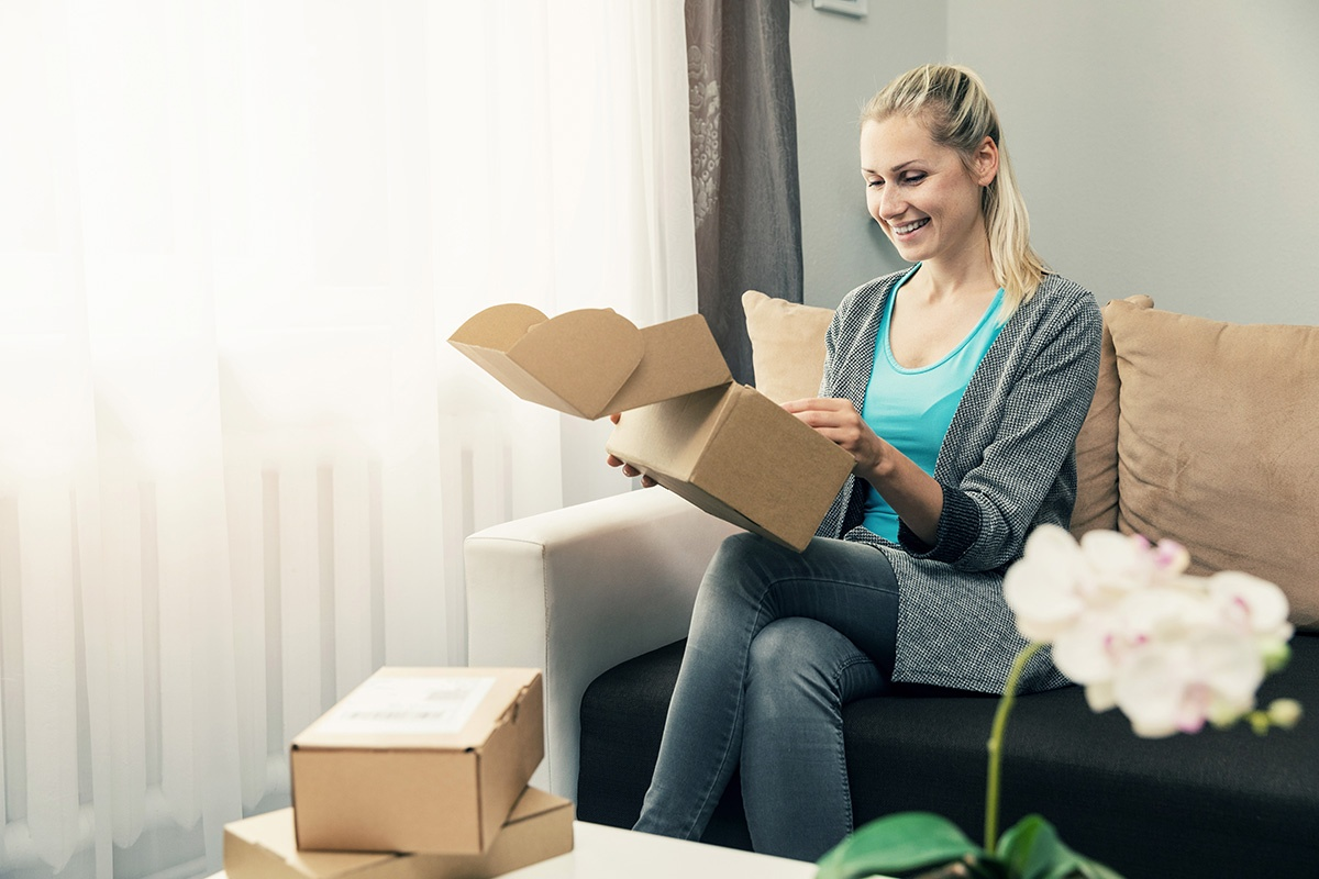 woman-opening-packages-brand-protection